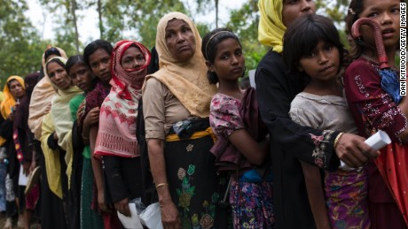 Rohingya refugee women queue for food rations after arriving from Myanmar to Bangladesh on September 10.