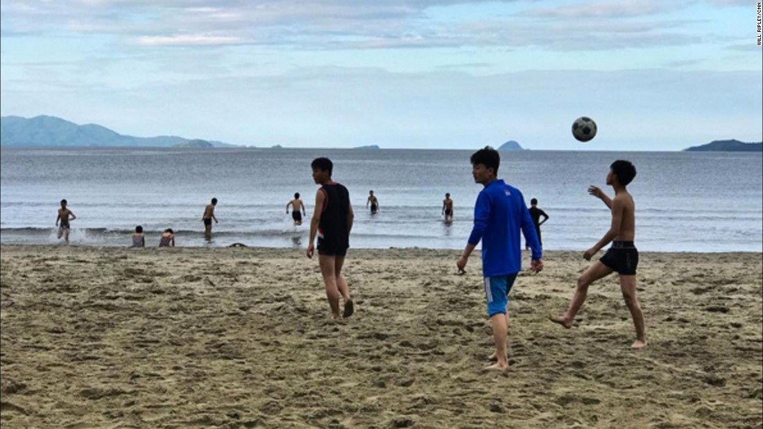 North Korean high school students play on a beach at Wonsan, on September 11, 2017.