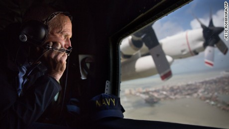 This photo provided by the Governor's Press Office, Gov. Rick Scott looks out the window of a C-130 as he looks at damage to the Florida Keys during the aftermath of Hurricane Irma, Monday, Sept. 11, 2017. (Jesse Romimora/Governor's Press Office, via AP)