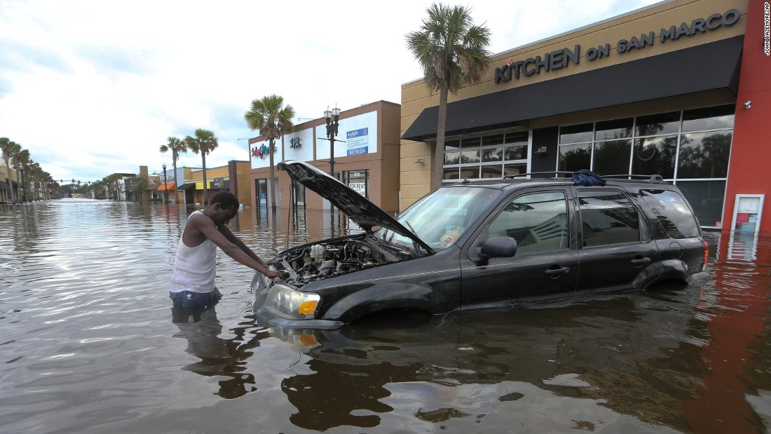 John Duke tries to salvage his flooded vehicle in Jacksonville on September 11.