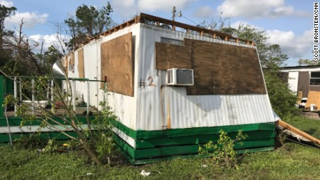 Residents boarded up their homes before they fled.