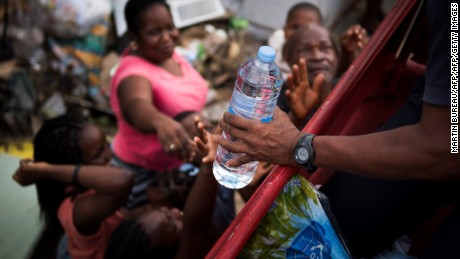 French firemen provide bottles of water to residents of Marigot, St. Martin, on September 10.