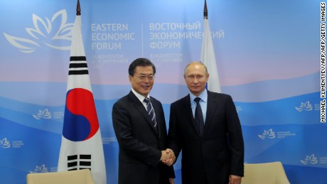 Russian President Vladimir Putin (R) shakes hands with South Korea's Moon Jae-in in Vladivostok on September 6, 2017.