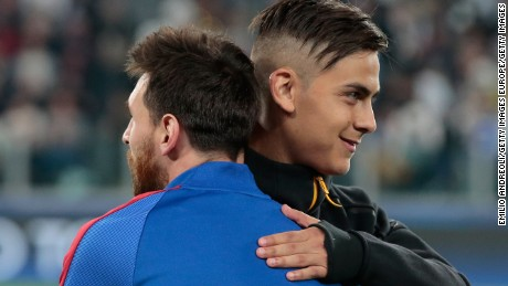 TURIN, ITALY - APRIL 11:  Paulo Dybala of Juventus FC embraces Lionel Messi of FC Barcelona during the UEFA Champions League Quarter Final first leg match between Juventus and FC Barcelona at Juventus Stadium on April 11, 2017 in Turin, Italy.  (Photo by Emilio Andreoli/Getty Images)