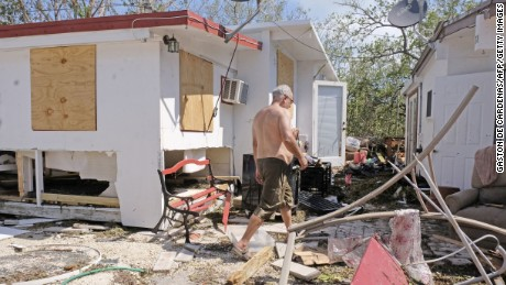 Gullermo Tejera, walks among the damamge to his mobile home in the wake of hurricane Irma at Tavenier Key, Florida on September 12, 2017. Hurricane Irma weakened slightly to a Category 4 storm early last Saturday, according to the US National Hurricane Center, after making landfall hours earlier in Cuba with maximum-strength Category 5 winds.  / AFP PHOTO / Gaston De Cardenas        (Photo credit should read GASTON DE CARDENAS/AFP/Getty Images)