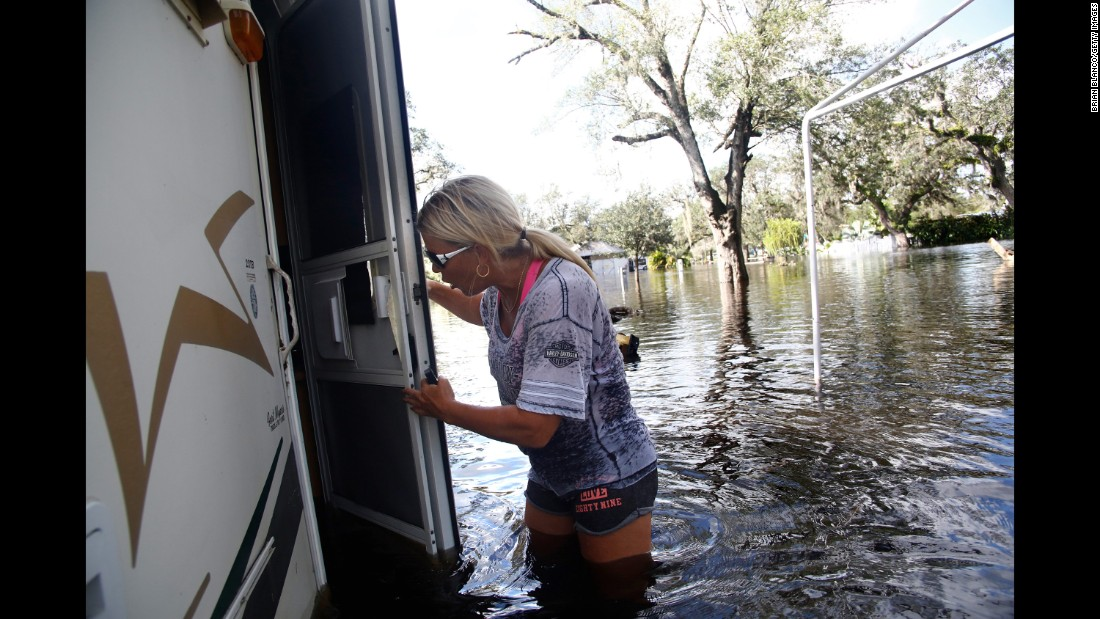 Waist-deep in floodwater, Shelly Hughes gets her first look at the inside of her camper in Arcadia, Florida, on September 12.