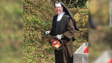Chainsaw-wielding nun clears debris after Irma