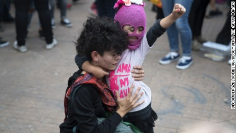 Demonstrators participate during a Ni Una Menos (Not One Less) rally in protest of gender based violence in Buenos Aires, Argentina, on Tuesday, April 11, 2017. Ni Una Menos (Not One Less) was launched by a group of journalists, artists, and activists demanding that women be protected from violent deaths at the hands of men in Argentina. Photographer: Pablo E. Piovano
