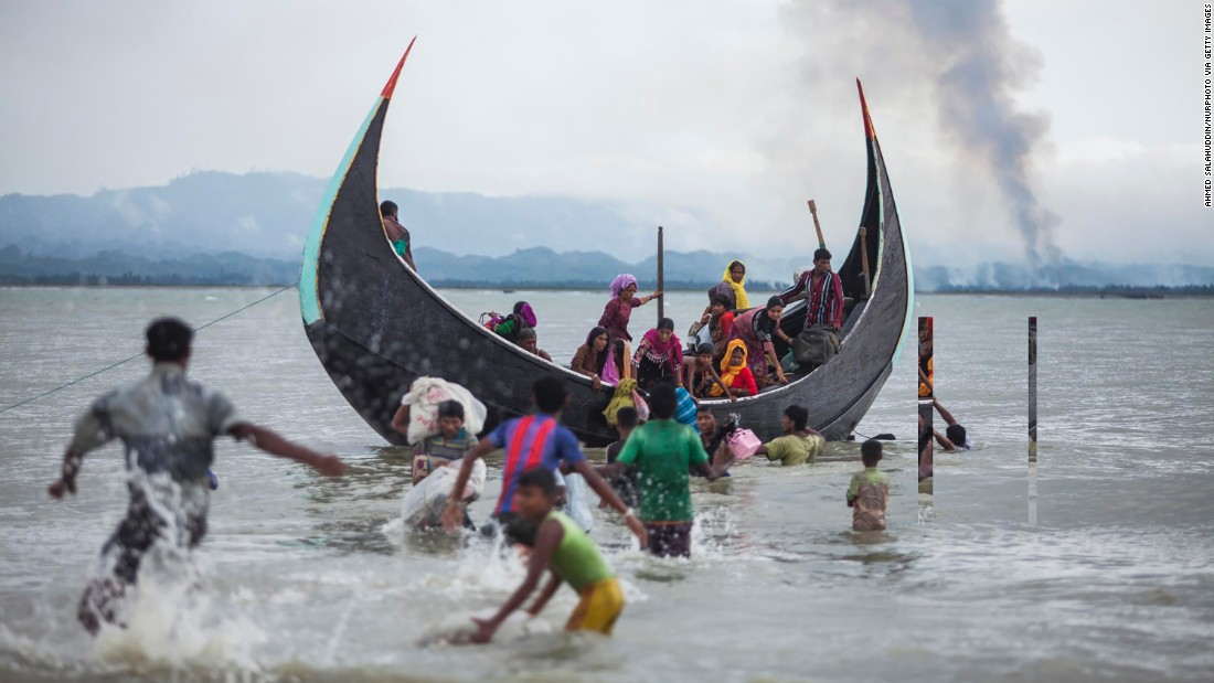 A boat full of Rohingya refugees arrives on the Bangladeshi side of the Naf River on September 9.