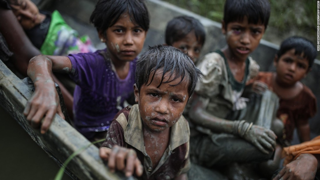 Rohingya children flee the Rakhine state by boat on Tuesday, September 12.