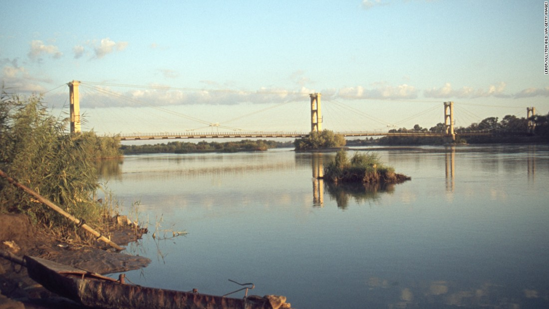 "This French-built suspension bridge was a popular pedestrian crossing and vantage point for its views of the Euphrates River. It became a key supply line in a battle for the city, and <a href=""http://www.syriadeeply.org/articles/2013/11/2595/crossing-bridge-death-deir-ezzor/"" target=""_blank"">collapsed under shelling.</a> Deir Ez-zor's Siyasiyeh Bridge was also destroyed."