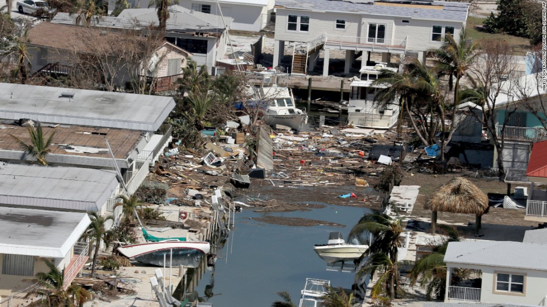 Debris litters the area around a group of homes in the Florida Keys on Wednesday, September 13.