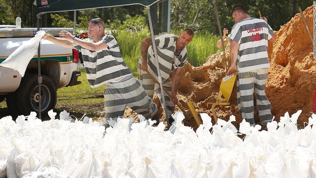Lake County jail inmates fill sandbags in Astor, Florida, on September 13.