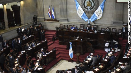 Guatemalan deputies attend a session of the Congress to vote to maintain or not the immunity of Guatemalan President Jimmy Morales accused of corruption in Guatemala City on September 11, 2017. Guatemala's congress on Monday voted overwhelmingly to reject a UN-backed request to lift the immunity of President Jimmy Morales in order for him to face a corruption probe over irregular campaign financing. Only 25 lawmakers voted in favour of the motion to strip Morales of his immunity, far fewer than the 105 needed in the 158-member legislature.  / AFP PHOTO / JOHAN ORDONEZ        (Photo credit should read JOHAN ORDONEZ/AFP/Getty Images)