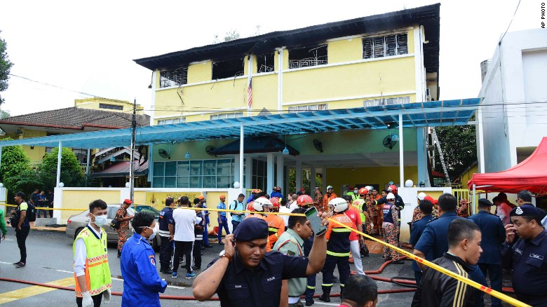Police and rescue personnel work at an Islamic religious school cordoned off after a deadly fire on the outskirts of Kuala Lumpur on Thursday, September 14, 2017.
