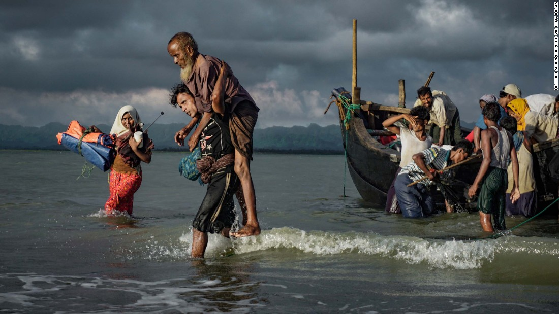 Rohingya refugees disembark from a boat on the Bangladeshi side of the Naf River on Wednesday, September 13.