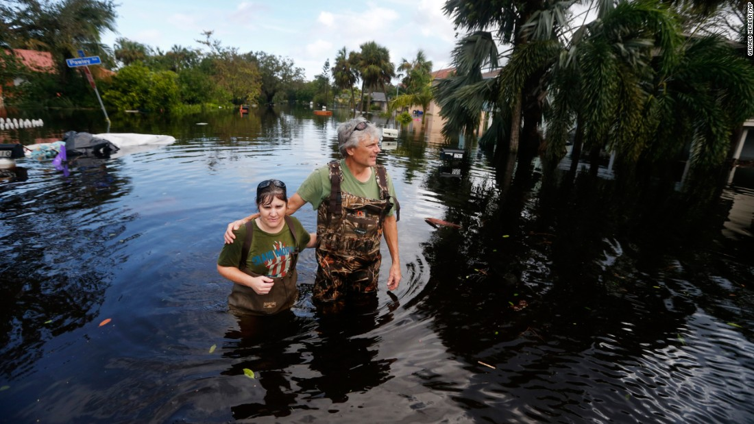 Kelly McClenthen returns to her flooded home with boyfriend Daniel Harrison in the aftermath of Hurricane Irma in Bonita Springs, Florida.
