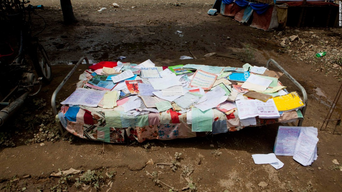 Personal papers and notebooks recovered from a flooded home are spread out on a cot in the aftermath of Hurricane Irma in Fort-Liberté, Haiti.
