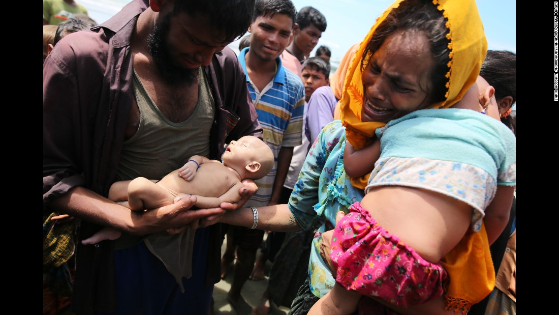 "Rohingya refugees fleeing Myanmar hold their infant son Abdul Masood, <a href=""http://www.cnn.com/2017/09/14/asia/myanmar-rohingya-muslim-family-mourns-infant-son/index.html"" target=""_blank"">who died when their boat capsized</a> just before reaching Bangladesh on Wednesday, September 13. More than 370,000 Rohingya <a href=""http://www.cnn.com/2017/09/13/asia/gallery/rohingya-refugee-crisis/index.html"" target=""_blank"">have fled to Bangladesh</a> since August 25, according to the United Nations. <a href=""http://edition.cnn.com/specials/asia/rohingya"" target=""_blank"">The Rohingya</a> are a Muslim minority who live in Myanmar's Rakhine state but are not recognized as citizens by the government. They are considered by human-rights groups to be among the world's most persecuted people."