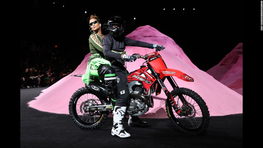 Singer Rihanna rides on the back of a motorbike during her Fenty Puma fashion show in New York on Sunday, September 10.