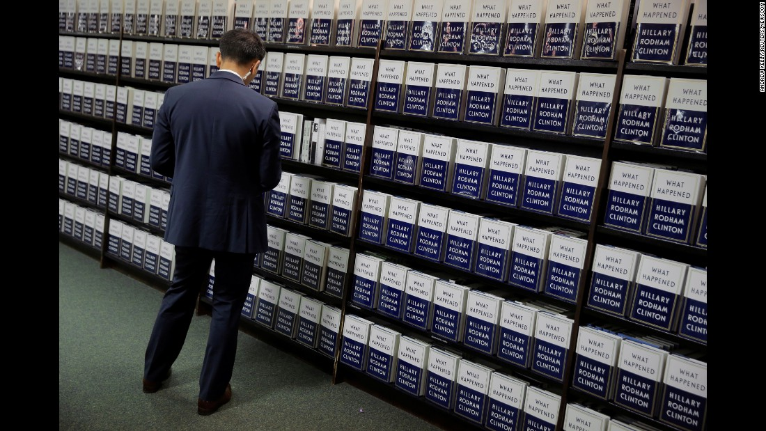 "A man looks at a copy of ""What Happened,"" Hillary Clinton's latest memoir, at a bookstore in New York on Tuesday, September 12. In the book, <a href=""http://www.cnn.com/2017/09/12/politics/hillary-clinton-what-happened-grievances/index.html"" target=""_blank"">Clinton reflects on the 2016 presidential election</a> and her loss to Donald Trump."