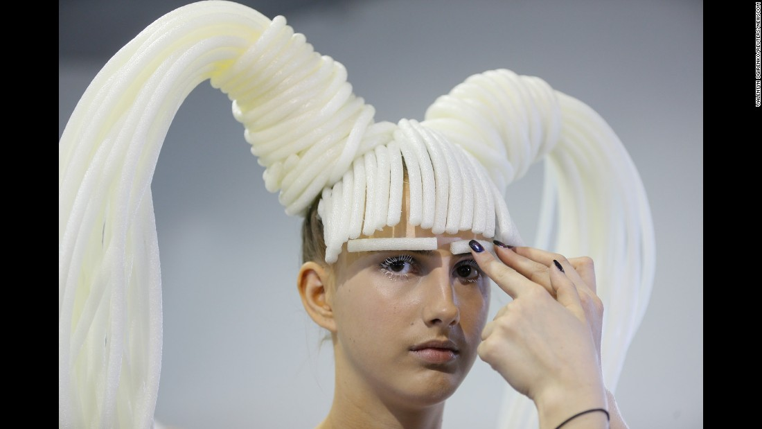 A model prepares backstage at a fashion show in Kiev, Ukraine, on Saturday, September 9.