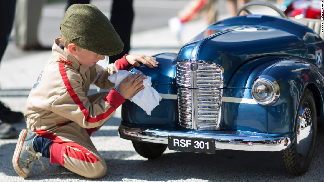 "A boy wipes down a pedal car Saturday, September 9, at the <a href=""https://petrolicious.com/articles/the-settrington-cup-is-where-the-kids-get-to-race-at-goodwood"" target=""_blank"">Settrington Cup,</a> a children's race held annually at the Goodwood Revival festival in Chichester, England."