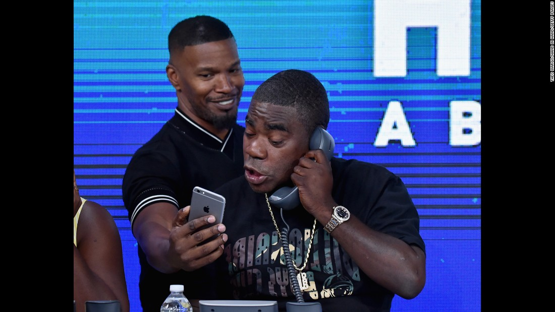"Jamie Foxx shows a phone to fellow actor Tracy Morgan as they take part in the ""Hand in Hand"" telethon in New York on Tuesday, September 12. <a href=""http://www.cnn.com/2017/09/12/entertainment/harvey-irma-celebrity-telethon/index.html"" target=""_blank"">More than 60 celebrities took part in the telethon,</a> which raised money for hurricane relief."