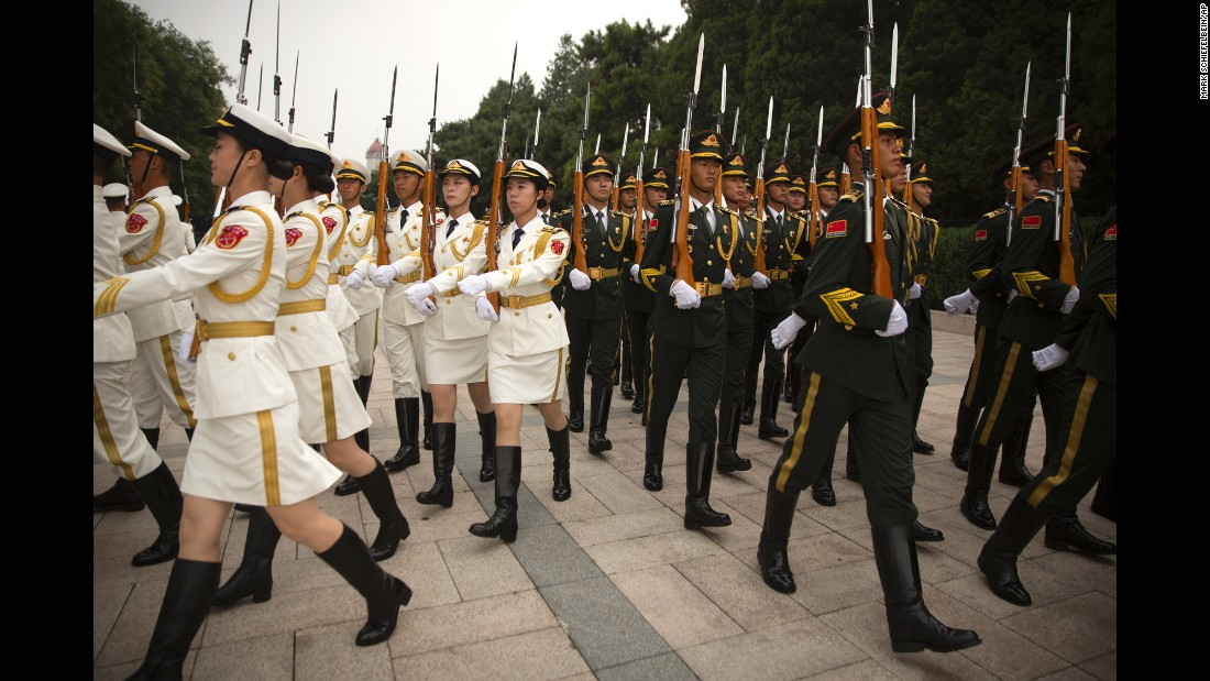 Chinese honor guard members march in formation Wednesday, September 13, before a welcoming ceremony for Brunei Sultan Hassanal Bolkiah.