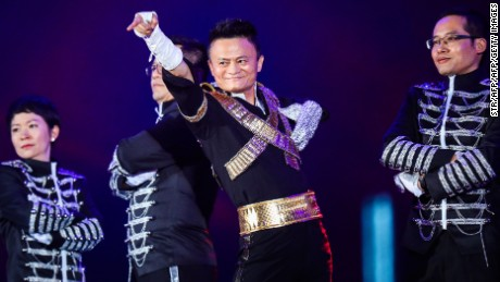 This photo taken on September 8, 2017 shows Jack Ma, chairman of Alibaba group, dancing to a medley of Michael Jackson songs during the Alibaba Annual Party at the Huanglong sports center in Hangzhou in China's eastern Zhejiang province.  Ma danced with other Alibaba employees during the party, which was held to celebrate the 18th anniversary of the company's founding. / AFP PHOTO / STR / China OUT        (Photo credit should read STR/AFP/Getty Images)