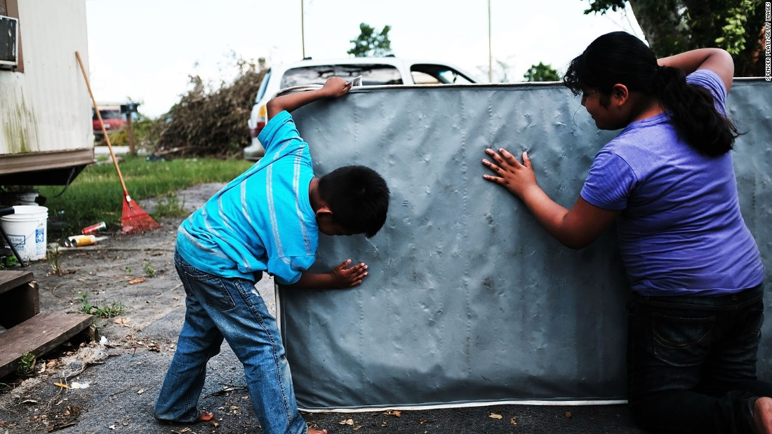 "Children clean a dirty mattress from a flooded home in Immokalee, Florida, on Thursday, September 14. Hurricane Irma <a href=""http://www.cnn.com/2017/09/07/americas/gallery/hurricane-irma-caribbean/index.html"" target=""_blank"">laid waste to beautiful Caribbean islands</a> and caused historic destruction across Florida. The cleanup will take weeks; recovery will take months."