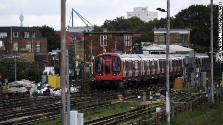 A Tube train is seen stopped at Parsons Green station on Friday.