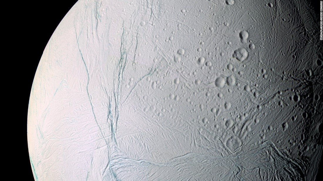 "Saturn's moon, Enceladus, is a small, icy world. For scientists, it's also one of the most interesting places in our solar system. Cassini discovered Enceladus is an active moon with a global ocean of liquid salty water beneath its crust. Planetary scientists now think Enceladus may possibly be hospitable to life.  ""Enceladus discoveries have changed the direction of planetary science,"" said Cassini project scientist Linda Spilker. This mosaic was created from 21 false-color images taken during Cassini's close approaches to Enceladus on March 9 and July 14, 2005."