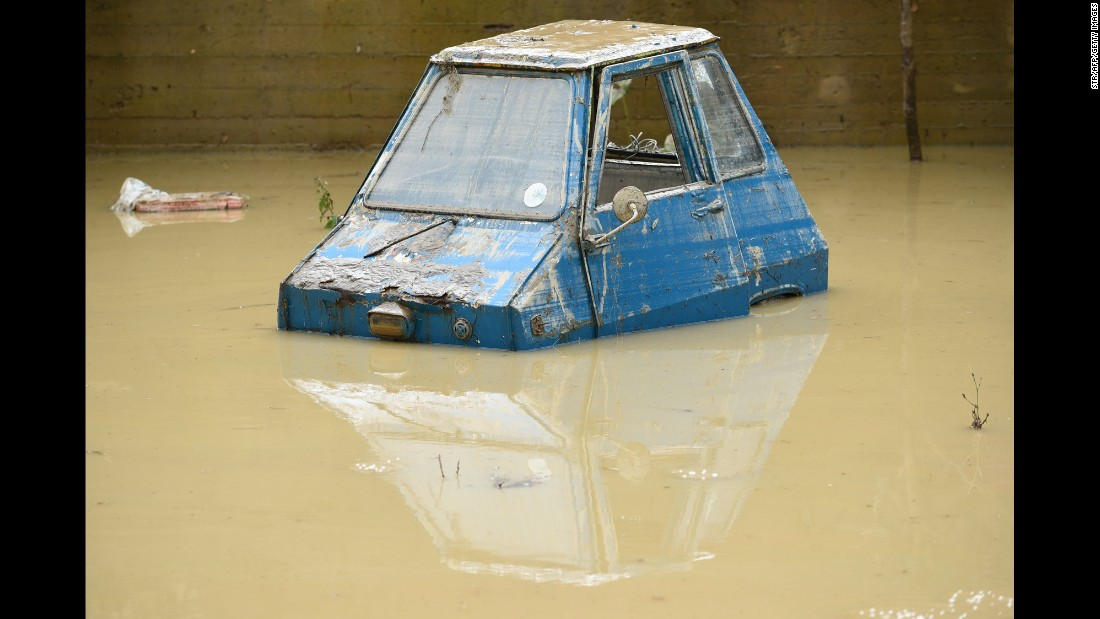 "A car is partially submerged in Livorno, Italy, on Sunday, September 10, after heavy rainstorms <a href=""http://www.cnn.com/2017/09/11/europe/tuscany-flooding/index.html"" target=""_blank"">triggered severe flooding</a> in the Tuscany region."