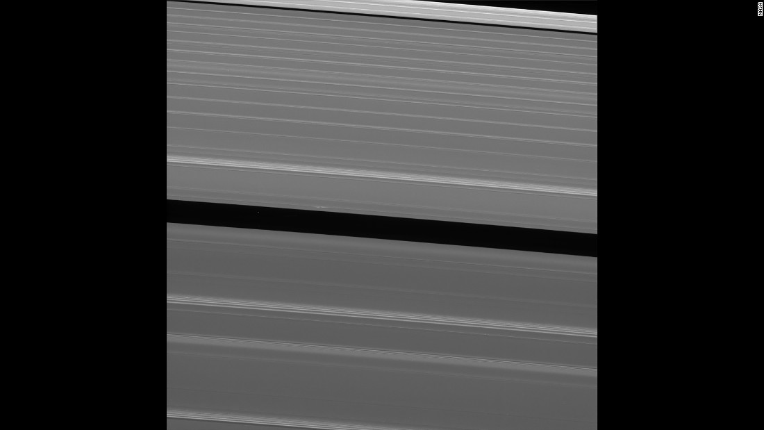 "Two days before its death plunge into Saturn, Cassini took this image of Saturn's A ring. The ring features what scientists call a lone ""propeller"" -- a feature created by small moonlets in the rings."