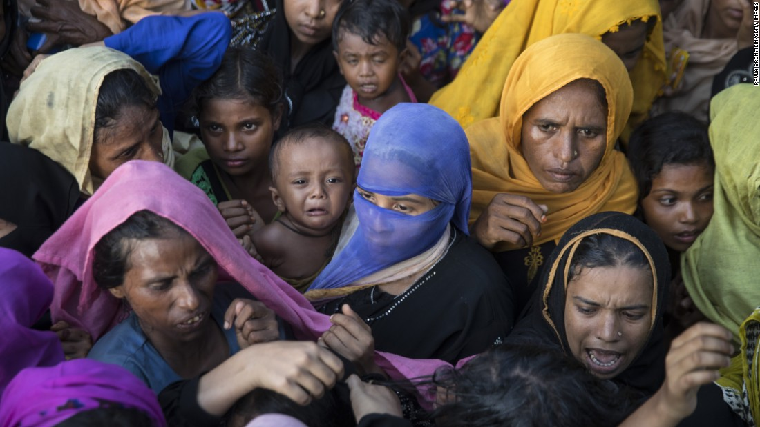 "Desperate Rohingya grab for handouts of clothing and food on Friday, September 15, 2017, in Tankhali, Bangladesh. As many as 400,000 Rohingya have fled to Bangladesh since August 25, according to the United Nations. <a href=""http://edition.cnn.com/specials/asia/rohingya"" target=""_blank"">The Rohingya</a> are a Muslim minority who live in Myanmar's Rakhine State but are not recognized as citizens by the government. They are considered by human rights groups to be among the world's most persecuted people."