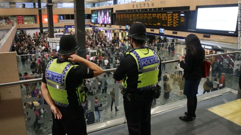 British Transport Police monitor activity Saturday at Euston Station in London.