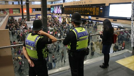 British Transport Police monitor activity Friday at Euston Station in London.