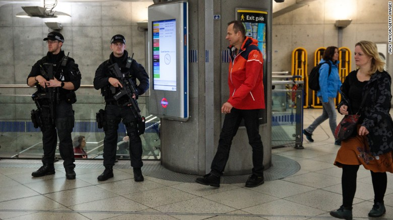 Armed police patrol in Westminster Underground station on Saturday.