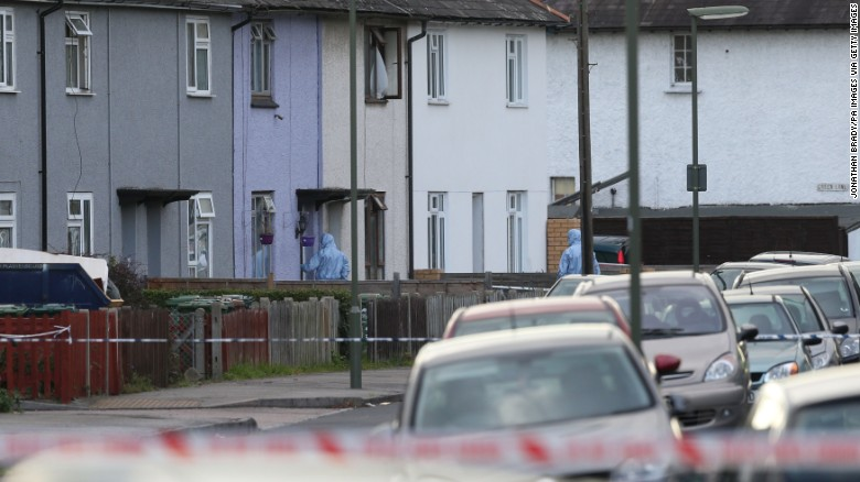 Forensic officers take part in an operation in Sunbury-on-Thames, Surrey, as part of the investigation into the Parsons Green bombing on Saturday.