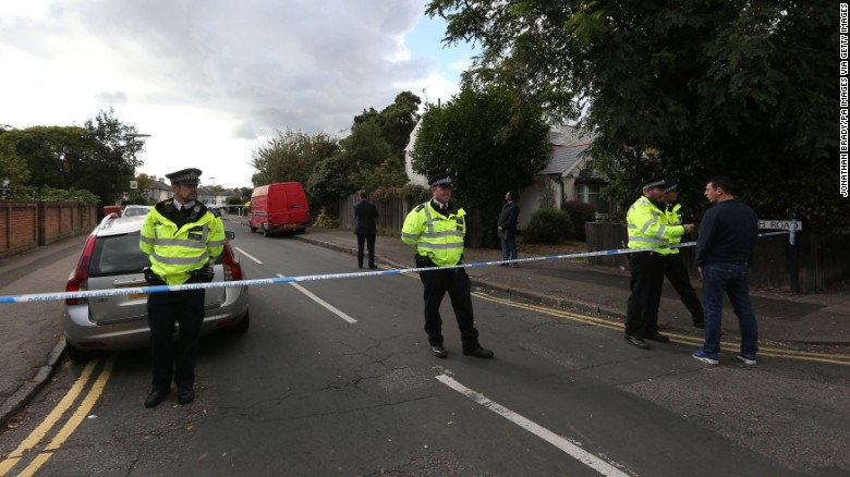 Officers stand guard at the perimeter of a police cordon in Sunbury on Saturday.