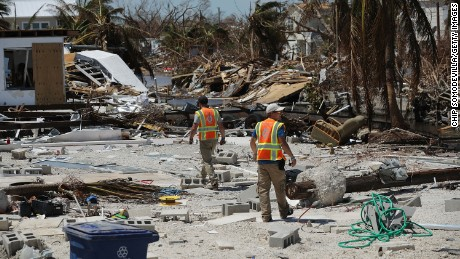 MARATHON, FL - SEPTEMBER 15:  Rescue volunteers Ian Beaumont (L) and Sam Kichline of What's Next Adventures search for people in a waterfront neighborhood hard hit by Hurricane Irma September 15, 2017 in Marathon, Florida. Many places in the Keys still lack water, electricity or mobile phone service and residents are still not permitted to go further south than Islamorada. The Federal Emergency Managment Agency has reported that 25-percent of all homes in the Florida Keys were destroyed and 65-percent sustained major damage when they took a direct hit from Hurricane Irma.  (Photo by Chip Somodevilla/Getty Images)