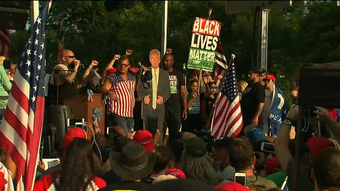 Black Lives Matter on stage at opposing rally