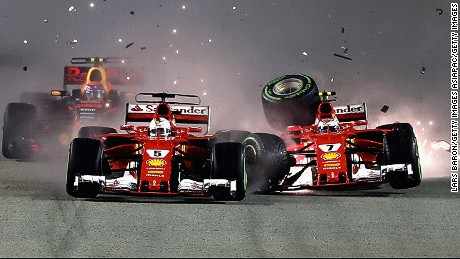 Sparks fly as Ferrari's Sebastian Vettel (left) and Kimi Raikkonen clash at the start of the Singapore Grand Prix