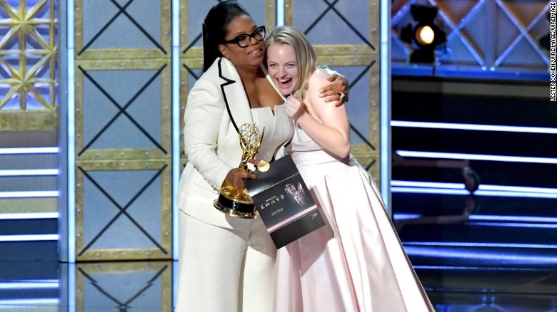 Oprah Winfrey  presents the outstanding lead actress in a drama series award for 'The Handmaid's Tale' to actor Elisabeth Moss.