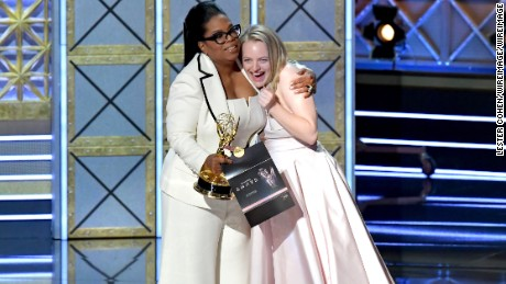 Oprah Winfrey (L) presents the outstanding lead actress in a drama series award for 'The Handmaid's Tale' to actor Elisabeth Moss onstage during the 69th Annual Primetime Emmy Awards at Microsoft Theater on September 17, 2017 in Los Angeles, California.  (Photo by Lester Cohen/WireImage)