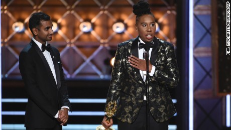 "Aziz Ansari, left, and Lena Waithe accept the award for outstanding writing for a comedy series for the ""Master of None"" episode ""Thanksgiving"" at the 69th Primetime Emmy Awards on Sunday, Sept. 17, 2017, at the Microsoft Theater in Los Angeles. (Photo by Phil McCarten/Invision for the Television Academy/AP Images)"