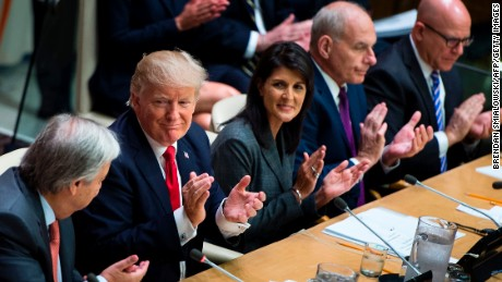 US President Donald Trump (2L), US Ambassador to the UN Nikki Haley (C), White House Chief of Staff John Kelly (2R) and National Security Advisor H. R. McMaster (R) clap for UN Secretary-General Antonio Guterres (L) a meeting on United Nations Reform at the UN headquarters in New York on September 18, 2017. (BRENDAN SMIALOWSKI/AFP/Getty Images)