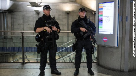 LONDON, ENGLAND - SEPTEMBER 16: Armed police patrol in Westminster Underground station on September 16, 2017 in London, England. An 18-year-old man has been arrested in Dover in connection with yesterday's terror attack on Parsons Green station in which 30 people were injured. The UK terror threat level has been raised to 'critical'. (Photo by Jack Taylor/Getty Images)
