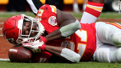 Kansas City Chiefs running back Kareem Hunt (27) pretends to sleep on the ball as he celebrates a touchdown during the second half of an NFL football game against the Philadelphia Eagles in Kansas City, Mo., Sunday, Sept. 17, 2017. (AP Photo/Ed Zurga)